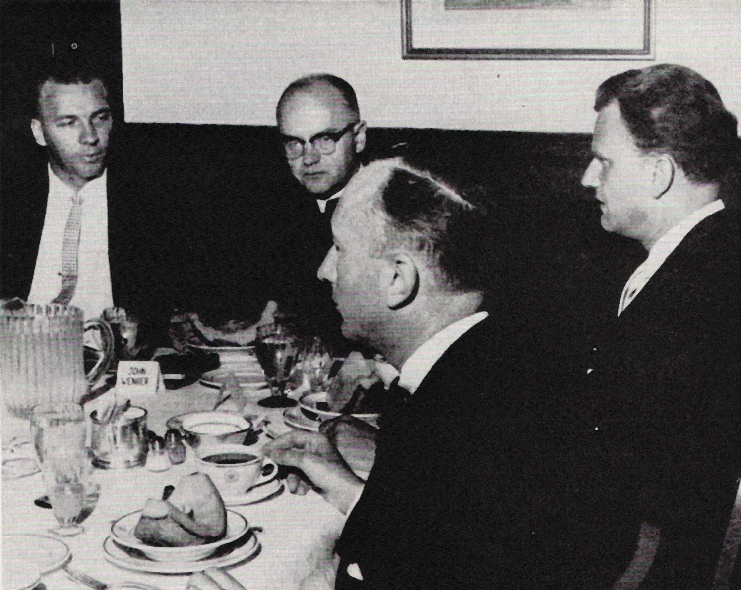 In this photo from the Evangelical Visitor, Billy Graham (third from left) meets with representatives of the Mennonite Church