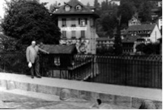 Bishop E. J. Swalm stands at the exact spot on the bridge in Switzerland where Anabaptists were put into a weighted cage and lowered into the water until they died. Then they were raised to be replaced with the next victim.