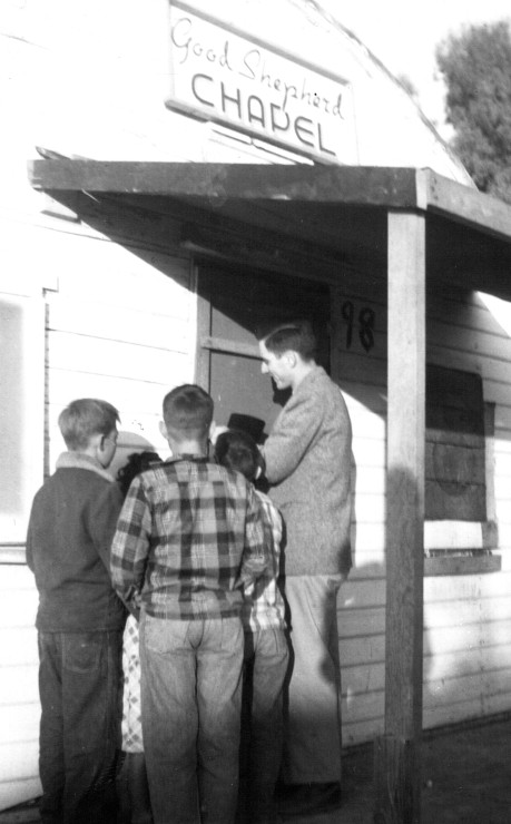 Home mission worker Carl Wolgemuth and several boys at the door to the mission chapel