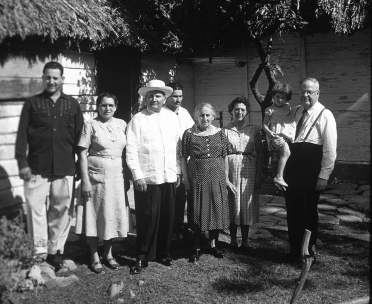Juana Garcia (second from the left) and her family in front of the home of her parents and siblings in the countryside near the town of Catalina. Jesse Cassel of Ohio is on the right. After the Wolgemuths left Cuba in 1960, Juana gave leadership to the church in Cuba for the next several decades.